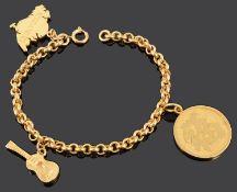 An Oriental yellow metal charm bracelet
