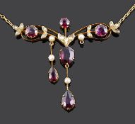 A delicate Edwardian garnet and seed pearl set scroll necklace
