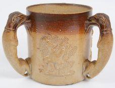 An early 19th Century Derbyshire salt glazed stoneware tyg