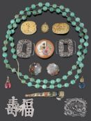 A small collection of Oriental jewellery including three carved Canton ivory brooches