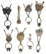 A collection of eight late Victorian skirt lifters