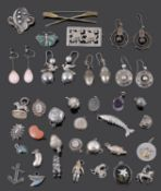 An interesting collection of Victorian silver earrings and a selection of mainly silver charms