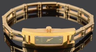A contemporary ladies gold plated Gucci 3900L wristwatch