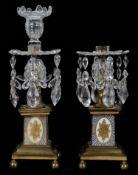 A pair of George III ormolu mounted lustre candlesticks (2)
