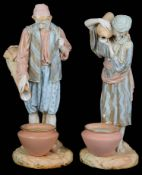 A pair of Royal Worcester porcelain figures of water carriers, c1894 and 1895 (2)