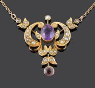 An Art Nouveau amethyst and seed pearl set scroll pendant necklace
