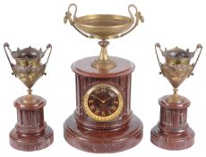 A late 19th century French three piece red marble and gilt metal clock garniture (3)
