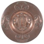 An Arts and Crafts copper alms dish