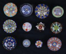 Twelve millefiore glass paperweights (12)