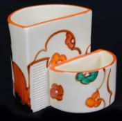 A Clarice Cliff Fantasque Farmhouse pattern cigarette and match holder