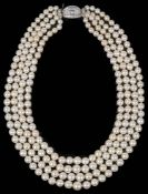 An impressive four row cultured pearl necklace with diamond set clasp