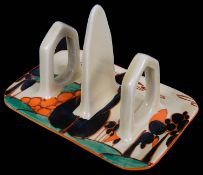 A Clarice Cliff Fantasque orange Trees and House pattern toast rack