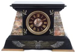 A late 19th Century French Egyptian Revival black slate and rouge mantel clock
