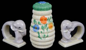 A rare pair of Art Deco Clarice Cliff napkin rings; one other (3)