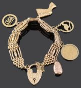 A 9ct gold fancy four bar gate bracelet and charms