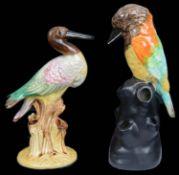 An unusual Art Deco Clarice Cliff bird flower holder; one other (2)