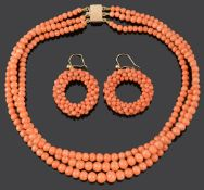 A three row natural coral bead necklace and coral hoop earrings