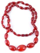 A single row necklace of graduated cherry amber beads