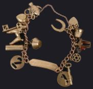 A delicate 9ct gold curb link charm identity bracelet