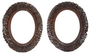 A pair of late 19th century Chinese Canton carved wood oval frames (2)