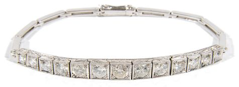 An attractive Edwardian diamond set graduated half line bracelet