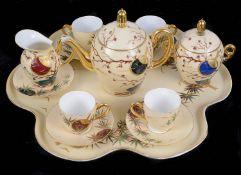 An early 20th century Limoges porcelain cabaret set