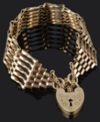 A contemporary 9ct gold six bar gate bracelet