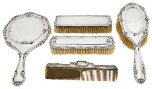 An Edward VII silver three piece silver backed dressing table set; others