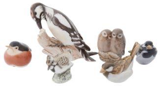 A collection of Royal Copenhagen and Bing & Grondahl porcelain bird figurines