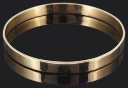 A plain Continental 9ct gold slave bangle