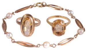 A pearl and 9ct gold delicate bracelet with two citrine rings