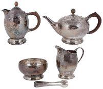 A five piece Liberty & Co. Arts and Crafts silver tea service model 5920