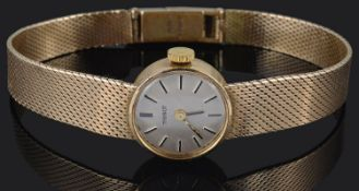 A ladies 1960s 9ct gold Tissot wristwatch and a 9ct gold Italian Indaerre belcher link bracelet