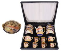 An early 20th century Japanese porcelain Camel China six setting coffee service