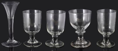 A mid 18th century wine glass and four 19th century pub rummers