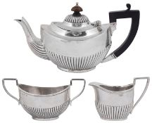 An Edward VII matched three piece silver bachelors tea service