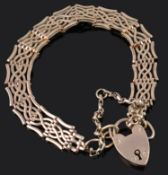 An early 20th Century rose gold coloured gate bracelet