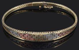 A contemporary three colour gold Italian woven gold bracelet