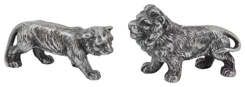 A pair of Edward VII naturalistically cast figures of a standing lion and lioness
