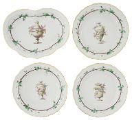 Four early 19th century creamware pottery dessert plates