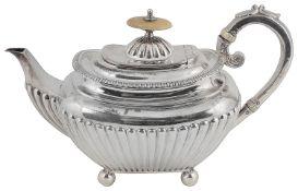 An Edward VII silver bachelors teapot