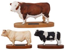 A Beswick Connoisseur Polled Hereford Bull on a wooden plinth and two others