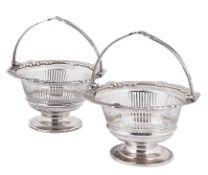 A pair of Edward VII silver swing handled bon bon baskets