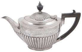 A late Victorian silver presentation teapot