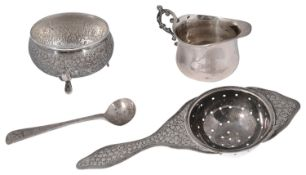 A Persian silver tea stainer and stand, a late Victorian small milk jug and a condiment spoon