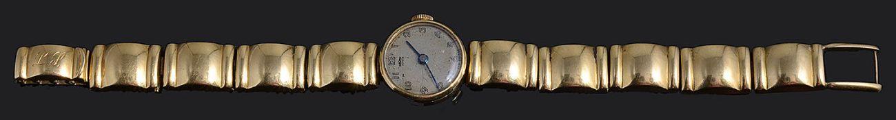 A ladies 18K gold wristwatch