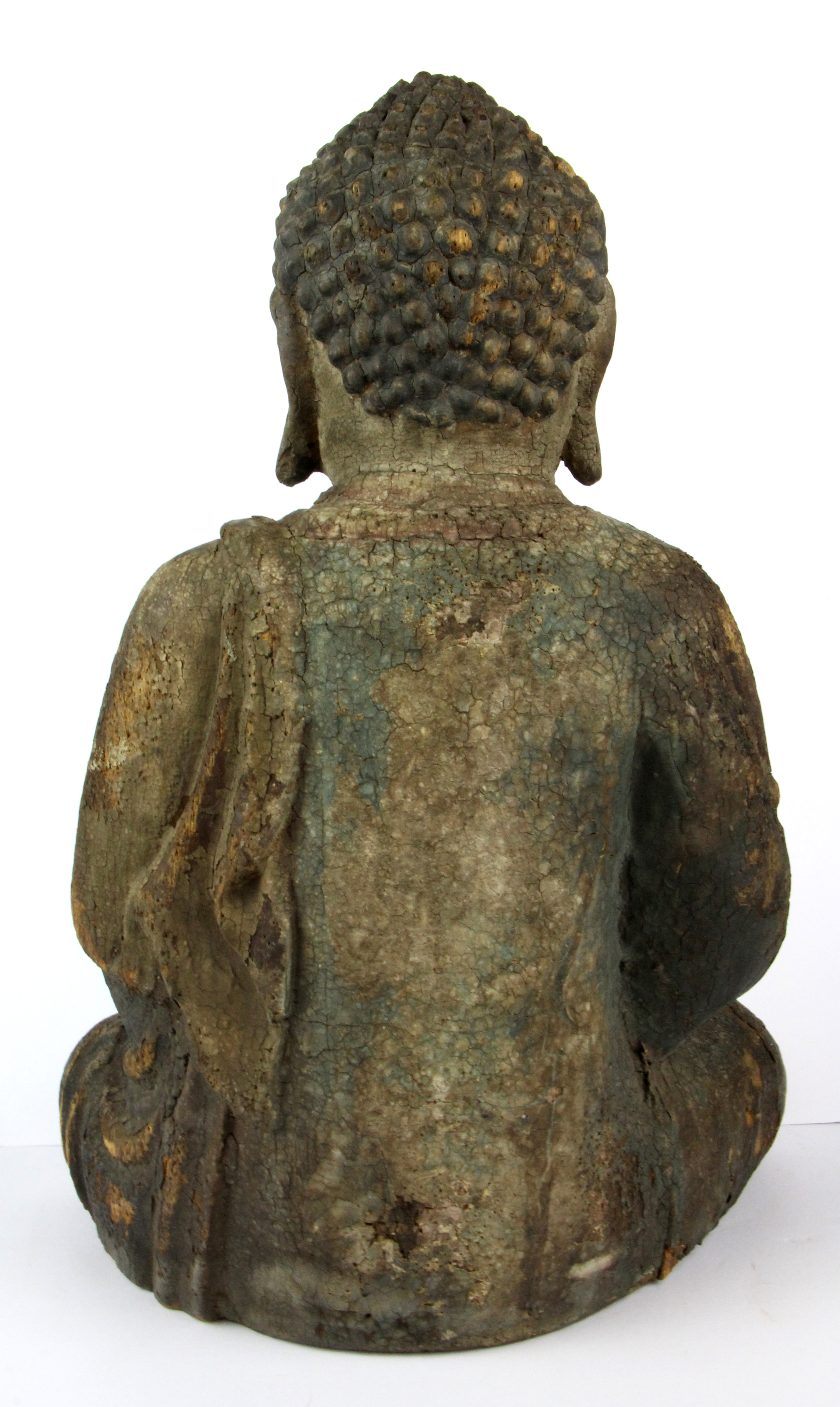 Lot 302 - A Chinese carved and gesso finished wooden temple Buddha, H. 43cm.