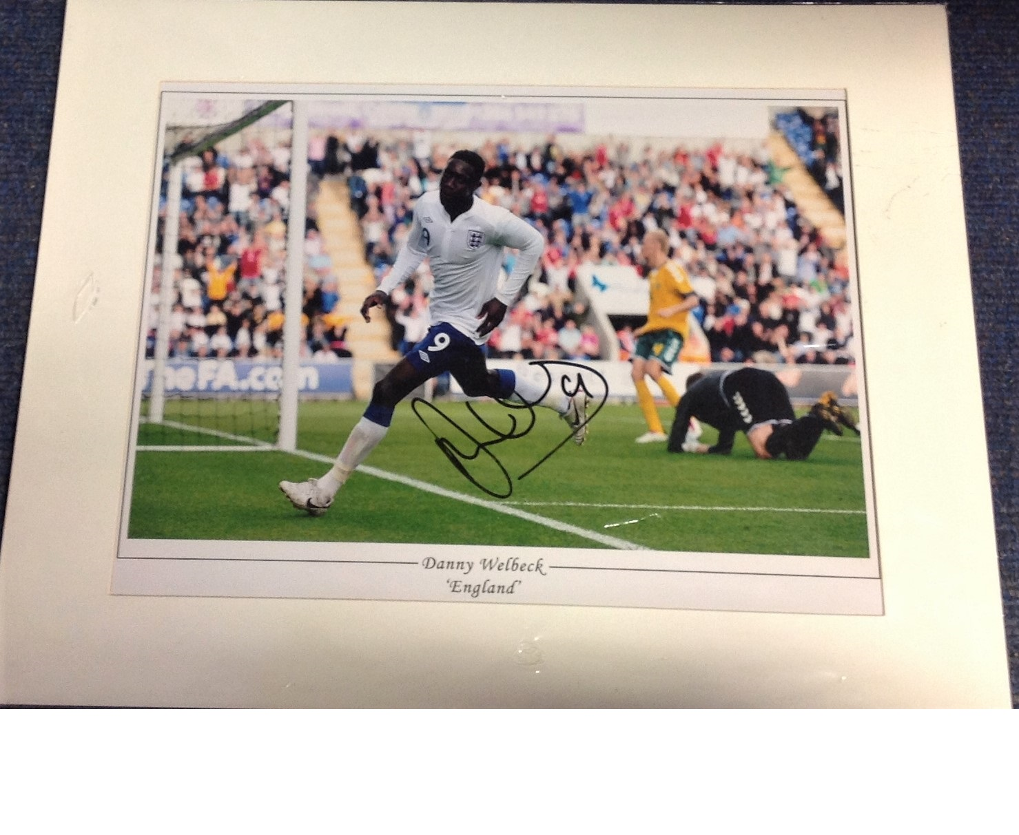 Lot 52 - Football Danny Welbeck signed 15x20 mounted colour photo pictured in action for England. Good