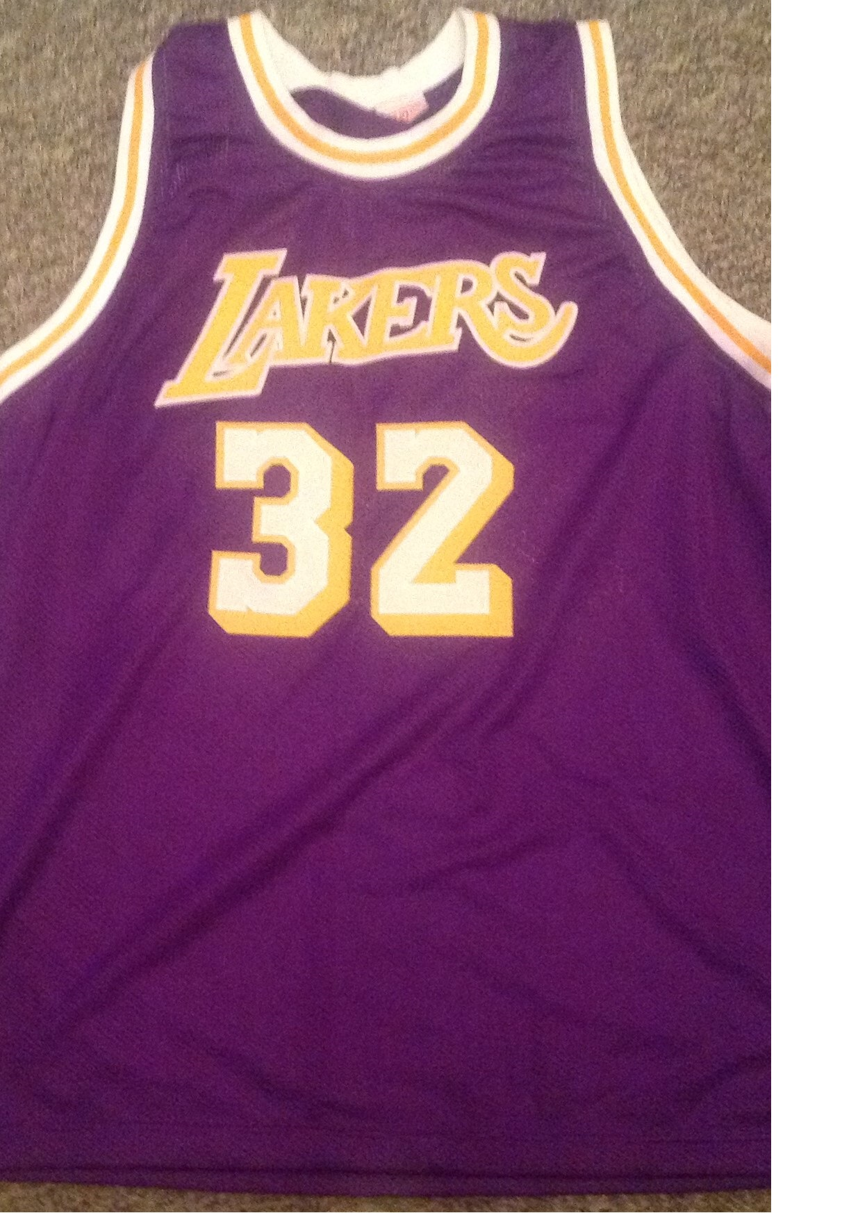 Lot 35 - Basketball Magic Johnson signed No32 Los Angeles Lakers jersey signed on the number on the back.