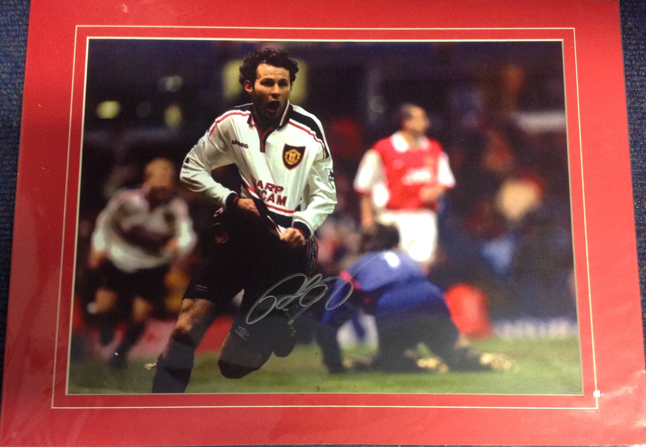 Lot 50 - Football Ryan Giggs signed 15x20 mounted colour photo pictured celebrating after scoring his